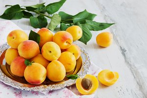 ripe apricots on a metal tray