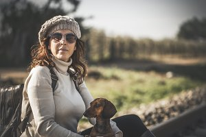 Attractive woman with red dachshund