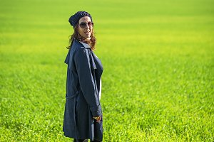 Woman walking in the green field