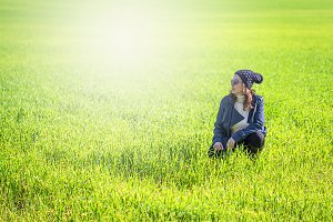 Woman in the green field