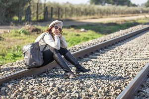 Woman walking along the railway