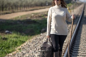 Woman alking along the railway