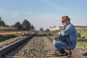 Adult traveller sitting on rails