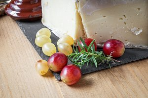 Close-up of grapes and cheese