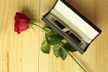 A red rose with a gift