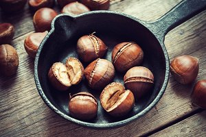 Roasted chestnuts on frying pan.