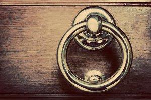 Golden door knocker.