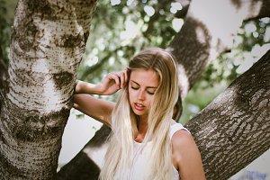 Dreamy woman in the garden