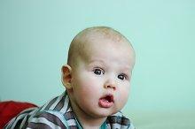cute little boy on green background