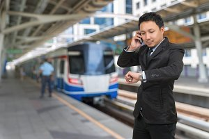 Young businessman talking on mobile
