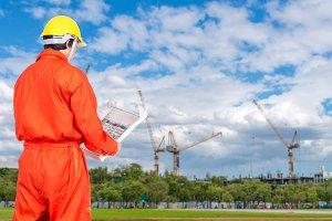 Asian engineers looking blueprint