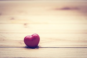 Red little heart on wood. Vintage.