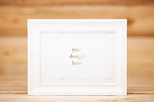 Cute frame on wood background
