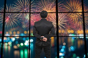 Businessman looking fireworks
