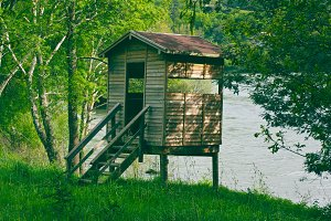 small cabin in the river