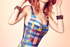 Beauty redhead woman in swimsuit