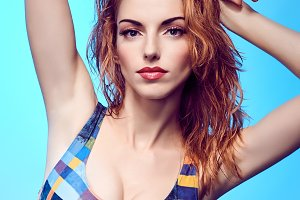 Beauty redhead woman in swimsuit