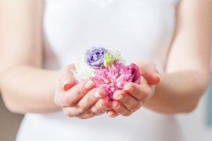 Fresh flowers in woman hand.