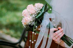 wedding bouquet in bride hand