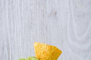 Guacamole with nachos and tomato