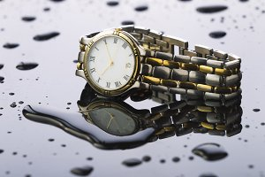 Wristwatches on a light background