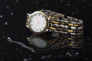 Wristwatches on a dark background