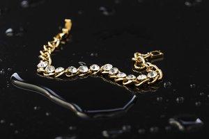 Gold bracelet with stones