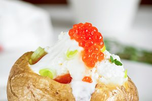 Baked potato with red caviar