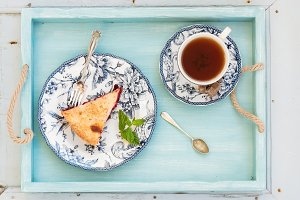 Piece of plum pie and cup of tea