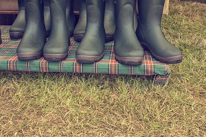 Row of green rubber boots