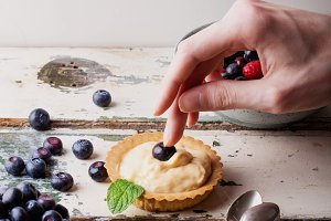 Berry Mini-Tarts with Male Hands