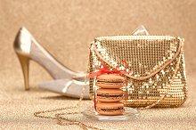 Macarons.Gold handbag,heels, bokeh