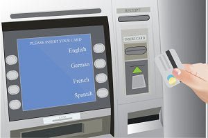 ATM machine and hands holding credit