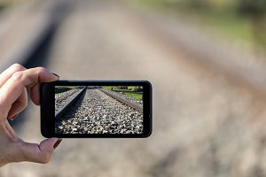Smartphone with photo of railway