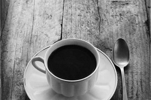 black coffee on rustic table