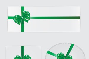 Green bow, ribbon and gifts