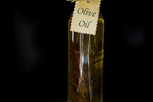 Olive oil on black background