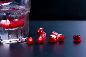 Vodka with pomegranate seeds