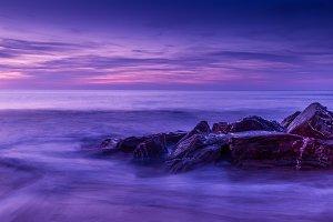 Stunning sunset on rocky coast