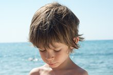 Boy applies sunscreen in his hand