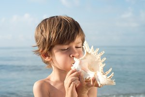 child blowing conch