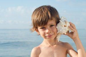 child listening conch