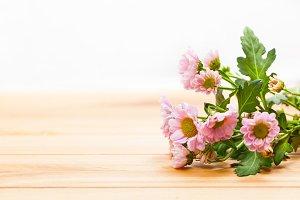 Spring flowers on rustic wood.
