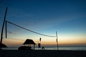 silhouette net volleyball beach