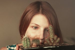 green eyed girl with cactus