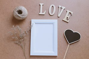 Photo frame mock up with love word