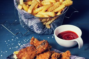 Chicken fries with fried potatoes
