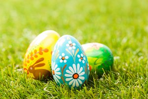 Hand painted Easter eggs on grass.
