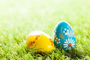 Hand painted Easter eggs in grass.