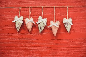Textile Hearts on Red Wall